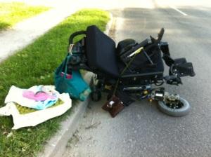 fallen broken wheelchair