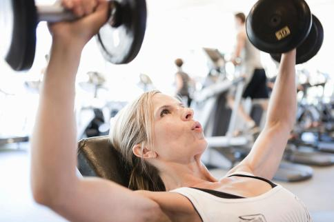 woman-lifting-free-weights-in-fitness-gym-assembly